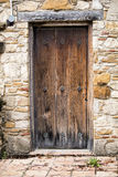 Rustic Door. A weathered door sits in a stone wall at one of the missions of San Antonio, Texas royalty free stock images