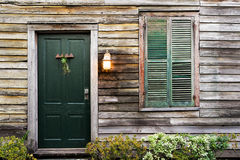 Rustic door and window with closed shutters Stock Images