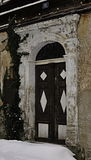 Rustic door. Rustic wood door in the classicism house Royalty Free Stock Photos
