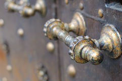 Rustic Doorhandle. A rustic metal door handle on door Royalty Free Stock Image