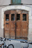 Rustic doors, Barcelona Spain. Pair of rustic wood folding doors in Barcelona Royalty Free Stock Photography