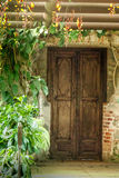 Rustic doorway with clockvine flowers Royalty Free Stock Photography