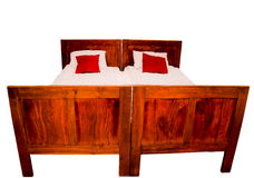 Rustic double bed - isolated Royalty Free Stock Photo