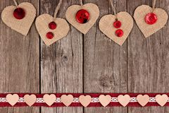 Rustic double border of Valentines hearts and ribbon on wood Stock Photos
