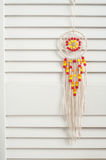 Rustic dream catcher with red and yellow wooden beads Royalty Free Stock Images