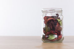 Rustic dried leaves in a glass jar with copy space stock photos
