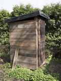 Rustic dry wc. Wooden rural building for excommunication, funny scene. Rustic dry wc. A wooden rural building for excommunication. Funny scenery from the garden royalty free stock image