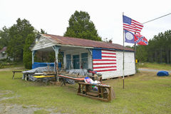 Rustic dwelling with American and Confederate flags along Highway 22 in Central Georgia Royalty Free Stock Photography