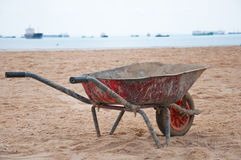 Rustic EarthMover on a Sandy Beach. An Empty Rusty Earthmover by the beach Royalty Free Stock Images