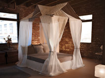 Rustic elegance. An elegant bed in a rustic room setting concept. 3D model Royalty Free Stock Images