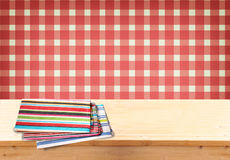Rustic empty wooden table with tablecloth and retro background. Ready for product display montages Stock Photography
