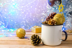 Rustic enamel cup with Christmas decorations over beautiful bokeh background stock photos
