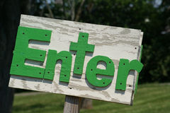 Rustic Enter Sign Green. Handmade rustic outside enter sign made of wood Royalty Free Stock Image