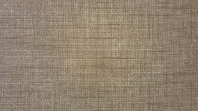 Rustic fabric texture in natural color. Gray background Royalty Free Stock Image