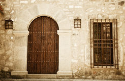 Rustic facade. Rustic house facade, wooden door Royalty Free Stock Photos