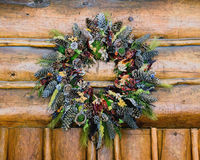 Rustic Fall Wreath Hung From a Log Cabin Structure Royalty Free Stock Photos