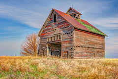 Rustic farm equipment barn Stock Images