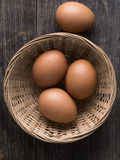 Rustic farm fresh chicken egg in basket Royalty Free Stock Photos