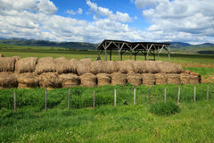 Rustic farm and hay bales. Old barn and hay bales, Wyoming, USA Royalty Free Stock Images