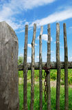 Rustic fence. Old wooden rustic fence and blue sky Royalty Free Stock Image
