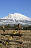 Rustic fence and mountain Stock Photo