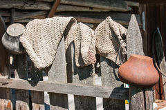 Rustic fence, pots and rugs in Palekh, Vladimir region, Russia Royalty Free Stock Images