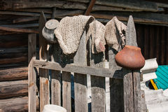 Rustic fence, pots and rugs in Palekh, Vladimir region, Russia Royalty Free Stock Photo