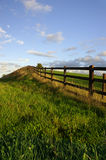 Rustic fence in rural setting. Rustic fence in lush rural setting in summer Stock Photo