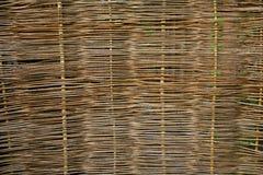 Rustic fence. Village. Wicker fence vine. handmade. craft Stock Photo