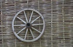 Rustic fence. Village. Wicker fence vine. wooden wagon wheel Royalty Free Stock Image
