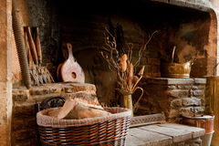 Rustic fireplace. 18th century rustic country fireplace in England Royalty Free Stock Photo