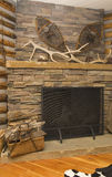 Rustic fireplace royalty free stock photography