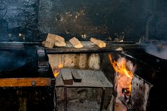 Firewood kitchen with fire on stock photography