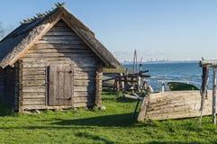 Rustic fisherman utility house and boats at sea coast Royalty Free Stock Image