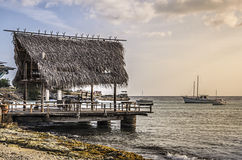 Rustic fishing pier in Curacao at sunset Stock Photo