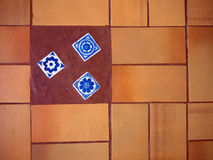 Rustic floor. Rustic orange floor decorated with blue inserts Royalty Free Stock Photos