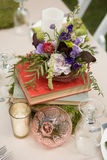 Rustic Floral Centerpiece with books. Rustic Floral Centerpiece on table arranged on top of books at wedding reception Stock Image