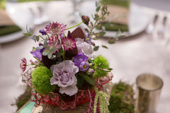 Rustic Floral Centerpiece. On table at wedding reception Royalty Free Stock Photography