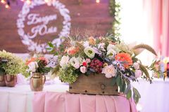 Rustic flower arrangement at a wedding banquet. Table set for an event party or wedding reception. Decor stock photos