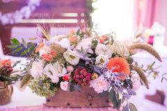 Rustic flower arrangement at a wedding banquet. Table set for an event party or wedding reception. Flowers royalty free stock image