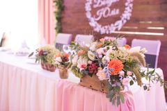 Rustic flower arrangement at a wedding banquet. Table set for an event party or wedding reception. Wedding royalty free stock image