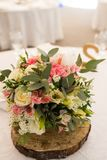 Rustic flower arrangement with white and pink flowers at a wedding banquet. Table set for an event party or wedding reception. Flowers stock images