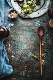 Rustic food  background with spice mill and wooden cooking spoon Royalty Free Stock Photo