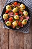 Rustic food: new potatoes, onions, tomatoes and bacon top view Stock Photo
