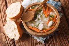 Rustic Food: rice soup in a wooden bowl. horizontal top view Stock Photo