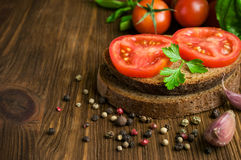 Rustic food : sandwiches of rye bread with tomato and basil Stock Photo