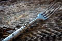 Rustic fork. On wooden table Stock Photo