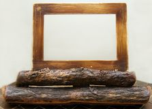 Rustic frame. Rustic picture frame made from 2 pieces of wood sitting on copper tiles. I make all of my rustic frames and mats royalty free stock photography