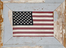 A Rustic Framed Vintage American Flag. A vintage American Flag displayed in an aged distressed painted wood frame royalty free stock photo
