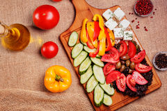 Rustic fresh Vegetables with Feta and olives. On rustic wooden board Stock Image